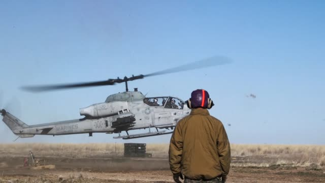 us marines with marine wing support squadron 274 and marine light attack helicopter squadron 269 conduct a forward arming and refueling point as part... - attack helicopter stock videos and b-roll footage