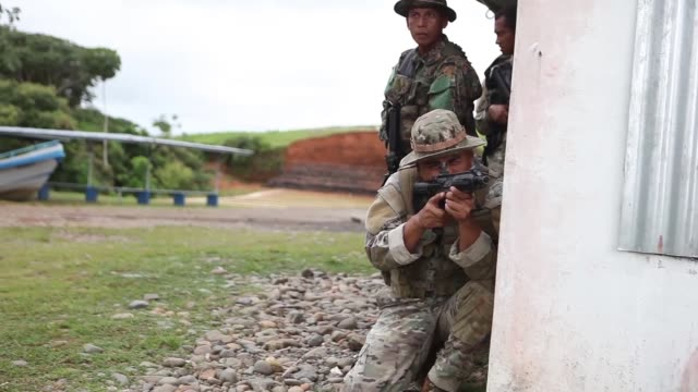 US Marines with Mobile Training Team One Special Purpose Marine AirGround Task Force Southern Command conduct tactical decision games with Panamanian...