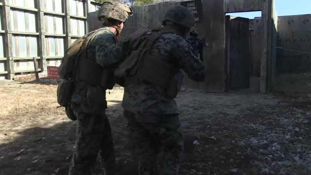 us marines with weapons company 3rd battalion 8th marine regiment 2d marine division participate in an urban assault course as part of a deployment... - us marine corps stock videos & royalty-free footage