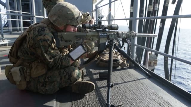 stockvideo's en b-roll-footage met marines with weapons company battalion landing team 1st battalion 4th marines conduct live fire as part of a defense of the amphibious task force... - amfibivoertuig