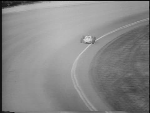 mario andrettti in race car speeding around curve on track at indy 500 / newsreel - curve stock videos & royalty-free footage