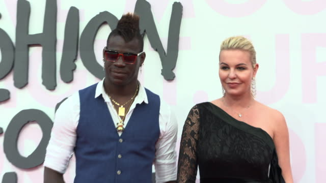 mario balotelli at fashion for relief fashion catwalk - the 71st cannes fillm festival at aeroport cannes mandelieu on may 13, 2018 in cannes, france. - カンヌ・マンデリュー空港点の映像素材/bロール