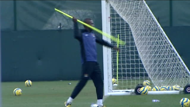mario balotelli leaves manchetser city for ac milan; t04011318 / england: manchester: mario balotelli on training pitch - throws corner post marker... - javelin stock videos & royalty-free footage