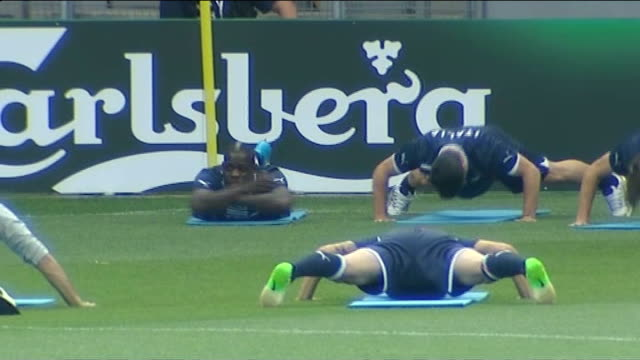 mario balotelli leaves manchetser city for ac milan; t22061208 / tx poland: krakow: mario balotelli lying on pitch with arms crossed whilst other... - autogramm stock-videos und b-roll-filmmaterial
