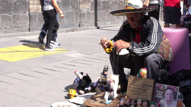 marionette performer on city street in mexico - puppet stock videos & royalty-free footage