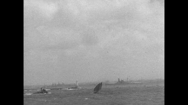 montage maritime flags flutter as the ss ionian arrives at the harbor in alexandria / alexandria, egypt - black and white stock videos & royalty-free footage