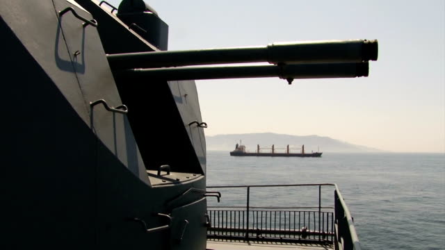 maritime transport under the cover of warships - battleship stock videos & royalty-free footage