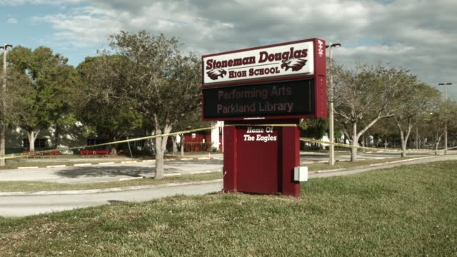 marjory stoneman douglas high school is seen on february 18 2018 in parkland florida police arrested 19 year old former student nikolas cruz for the... - trauernder stock-videos und b-roll-filmmaterial