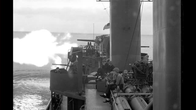 mark 12 5 inch guns fired from destroyer dd-612 uss kendrick / soldiers, sailors on deck covering ears, smoking. 2 mark 12 5 inch guns fired from uss... - inch stock videos & royalty-free footage