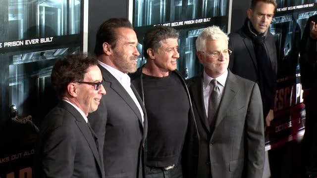 mark canton arnold schwarzenegger sylvester stallone and guest at escape plan new york premiere arrivals in new york ny - arnold schwarzenegger stock-videos und b-roll-filmmaterial