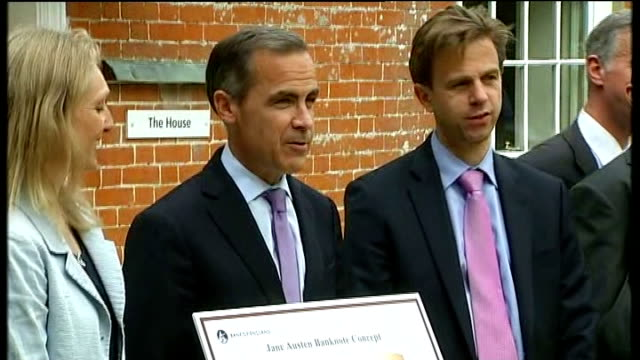 Mark Carney speech and unveiling of new Jane Austen ten pound note Mark Carney posing for photocall holding image of new Jane Austen ten pound note...