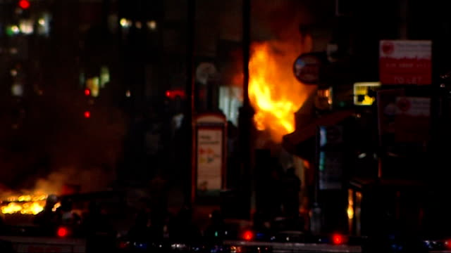 jury deliver lawful killing verdict; august 2011 london: various shots fires burning in street during london riots with police vans in foregound - juror law stock videos & royalty-free footage
