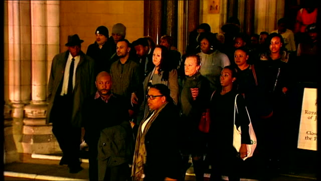 aunt appeals for calm at vigil and denies intimidation allegations ****flash 8th january 2014 high court various of family and friends of mark duggan... - aunt stock videos and b-roll footage