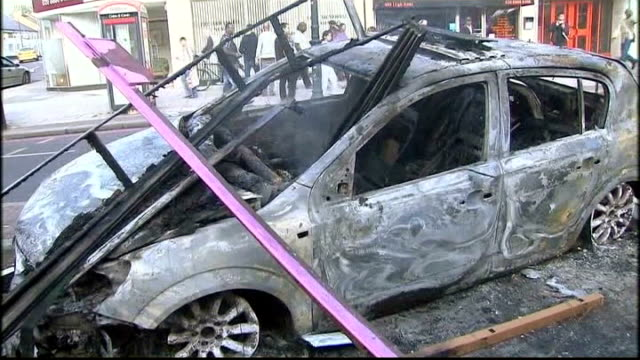 aunt appeals for calm at vigil and denies intimidation allegations august 2011 tottenham ext burnt out car after rioting burnt out bus firefighters... - aunt stock videos and b-roll footage