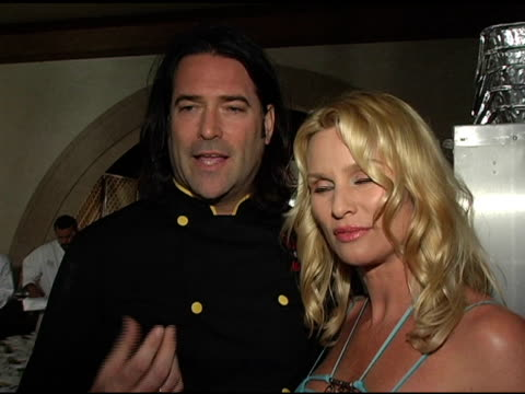 Mark E Kearney and Nicollette Sheridan at the American Red Cross Tsunami Benefit at Private Residence in Brentwood California on March 30 2005