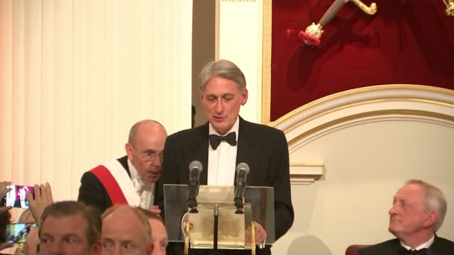 Mark Field suspended as minister after video shows him grabbing protester ENGLAND London Mansion House INT Philip Hammond MP at podium interrupted by...