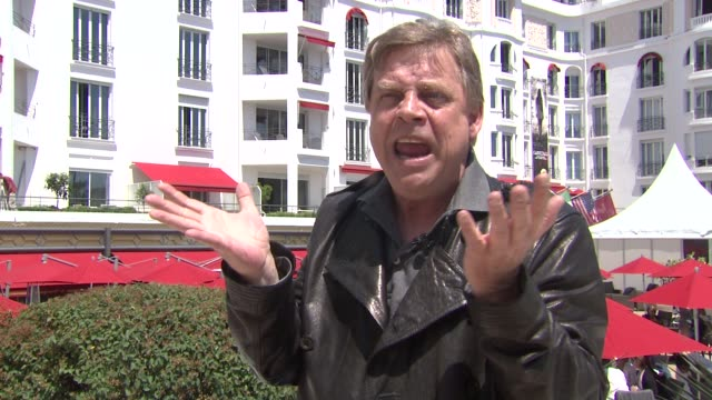 vídeos y material grabado en eventos de stock de mark hamill on still loving what he loved as a kid and how it's his passion at the mark hamill interview at cannes - mark hamill