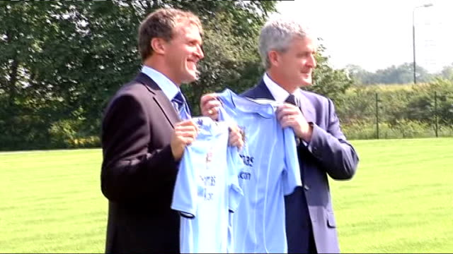 mark hughes becomes new manchester city manager england manchester int mark hughes holding up club's football shirt for photocall alongside gary cook... - shaky stock videos & royalty-free footage