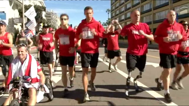 Mark Ormrod running on 'blade' prosthetic legs with other Royal Marines Mark Ormrod interview SOT