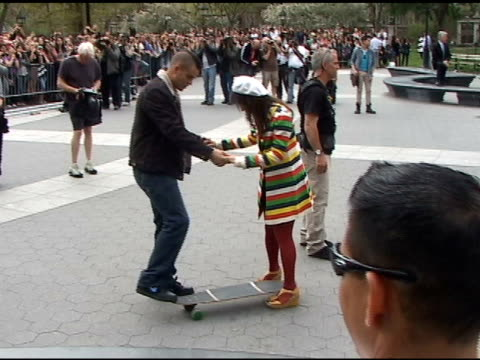 mark salling teaches lea michele the fine art of skateboarding while on the set of the season finale of 'glee' in washington square park in greenwich... - glee tv show stock videos and b-roll footage