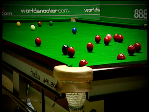 mark williams pots red with ambitious three ball plant world snooker championship crucible theatre sheffield 2006 - world championship stock videos & royalty-free footage