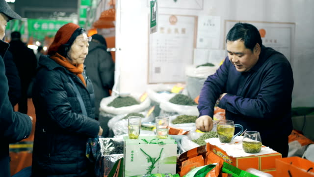 market for chinese spring festival goods,xi'an,china. - tea cup stock videos & royalty-free footage