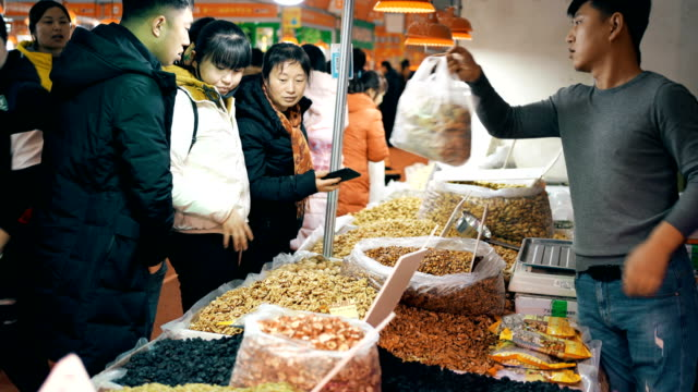 market for chinese spring festival goods,xi'an,china. - nutshell stock videos & royalty-free footage