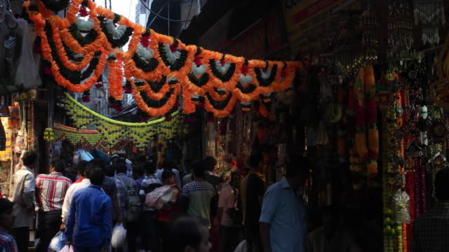 A market place in Old Delhi decorated with artificial flowers for Diwali in old Delhi