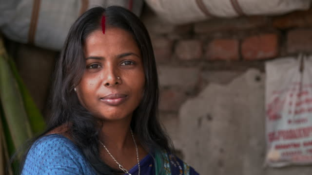 market seller with dark hair and bindi in forehead - bindi stock videos and b-roll footage