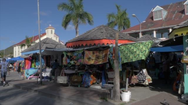 market stalls on back street in philipsburg, philipsburg, st. maarten, dutch antilles, west indies, caribbean, central america - tropical tree stock videos & royalty-free footage