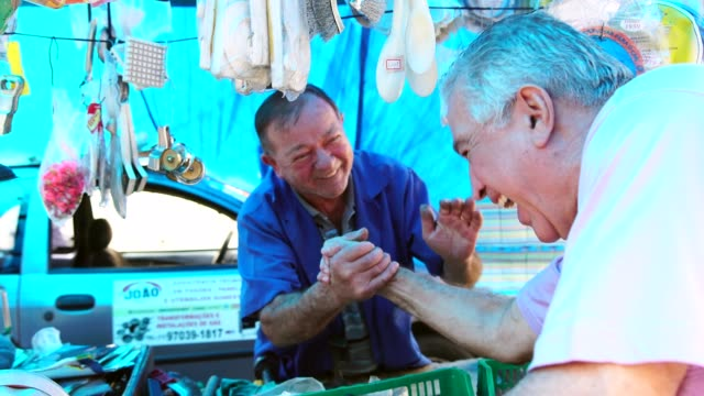 market vendor and customer handshake - retail occupation stock videos & royalty-free footage