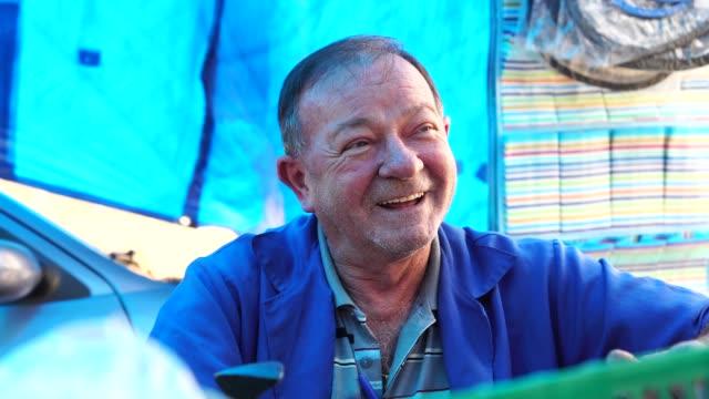 market vendor talking to the customer - pardo brazilian stock videos & royalty-free footage