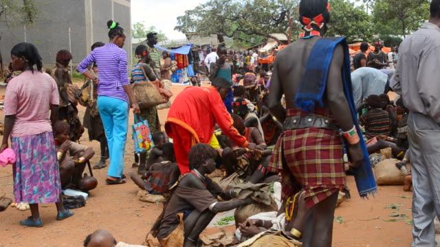 ms market with bena native women selling to locals / dimeka, ethiopia - corno d'africa video stock e b–roll
