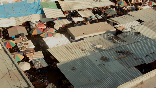 market with corrugated iron roofs in ramallah seen from above - ramallah stock videos and b-roll footage