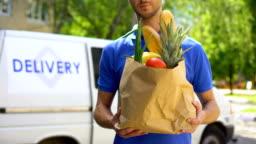 Market worker giving grocery bag, goods delivery service, express food order