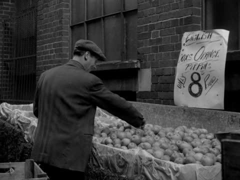 market workers preparing their fruit and flower barrows in wardour street soho. 1954. - market trader stock videos & royalty-free footage