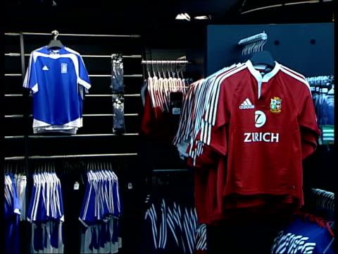 Adidas 'threestripe' brand under threat Adidas products for sale in sports shop