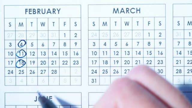 marking dates in calendar - personal organiser stock videos and b-roll footage