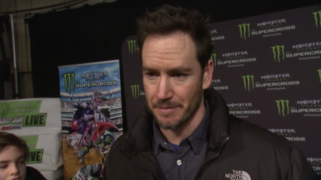 mark-paul gosselaar on the excitement of the event, his brother's involvement as a mechanic, and how much he loves the sport at monster energy... - angel stadium stock videos & royalty-free footage