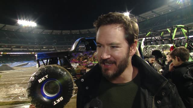 INTERVIEW MarkPaul Gosselaar on who are you here with today on what do you love about Monster Jam on who do you think is going to take home the event...