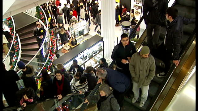 vídeos de stock e filmes b-roll de marks and spencer announce job losses / sales figures released england london shoppers along with christmas lights and sale signs - marks and spencer