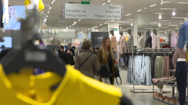 vídeos y material grabado en eventos de stock de marks and spencer; marks and spencer; women's clothes on display and customers along / oxford street: ext shoppers along on rainy street / sports... - finanzas y economía