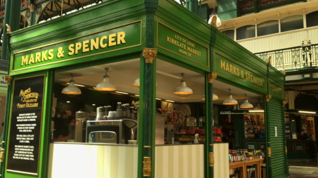 marks and spencer penny bazaar in kirkgate market. - yorkshire england stock videos & royalty-free footage