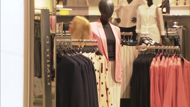 marks and spencer shop general views; england: london: int general views marks and spencer shop / customers shopping / clothes on display - finance and economy stock videos & royalty-free footage