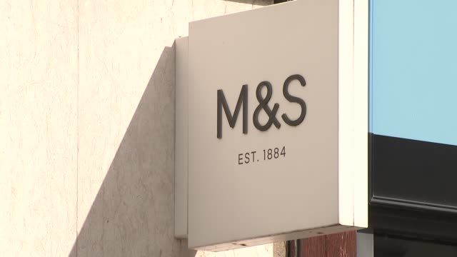 marks and spencer store and guildford high street general views; england: surrey: guildford: high street: ext people along high street and entering... - raw footage stock videos & royalty-free footage