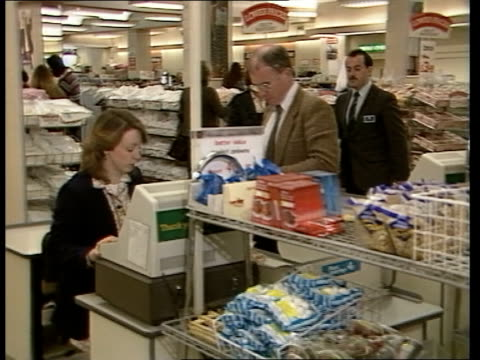 vídeos de stock e filmes b-roll de marks and spencer store celebrates its centenary england london ms customers at check out desk in marks and spencer food department zoom bv shop... - marks and spencer