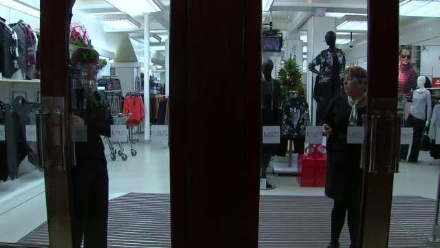 marks and spencer to close 30 stores england yorkshire ext people past marks and spencer store staff closing doors to store with christmas... - yorkshire england stock videos & royalty-free footage