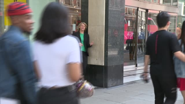 marks and spencer to close over 100 stores london holloway road reporter to camera as shoppers along past - channel 4 news stock videos & royalty-free footage