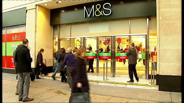 marks spencer announce store closures and job cuts tx people entering m s store with '20 per cent off christmas spectacular' sale signs in window '20... - cent sign stock videos & royalty-free footage