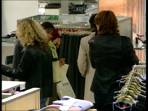 Marks Spencer to cut 450 jobs LIB INT GVs Women looking at clothes in store